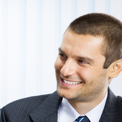 Happy smiling young businessman