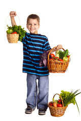 Smiling boy with vegetables in basket