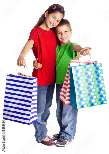 Happy kids with shopping bags