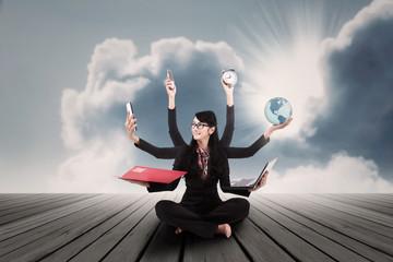 Businesswoman multitasking outdoor