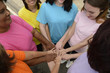 Group of women with hands together