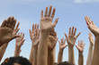 Hands Up against blue sky
