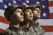 Three young military personnel in front of flag, horizontal - 55896401