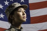 Military woman in front of US flag, horizontal