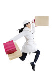 Happy shopper woman jumping