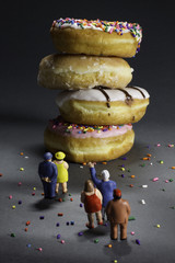 Supersize epidemic - people looking at doughnuts