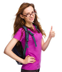 Young student girl is showing thumb up sign