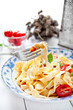 Italian fettuccine pasta with cherry tomatoes and parmesan