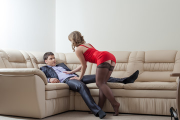 Curvy slim girl flirting with relaxing businessman