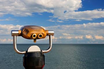 Modern looking golden pay binoculars in a Public Area