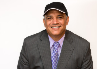 Smiling Hispanic man dressed in a business suit