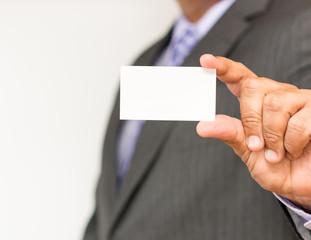 Business man holding an empty business card