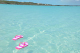 Flip-flops in the water. Great Exuma, Bahamas