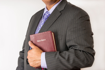 Business man holding a Bible