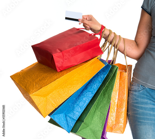 Woman's hand holding shopping bags