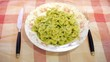 Italian pasta with pesto on table