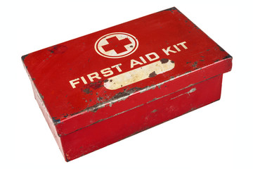Vintage first aid kit isolated on white
