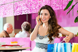 Young woman in ice cream parlor poster