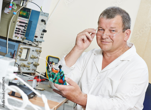 technician engineer at work with microchip