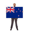 Smiling businessman holding a big card, flag of New Zealand