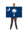 Smiling businessman holding a big card, flag of South Carolina
