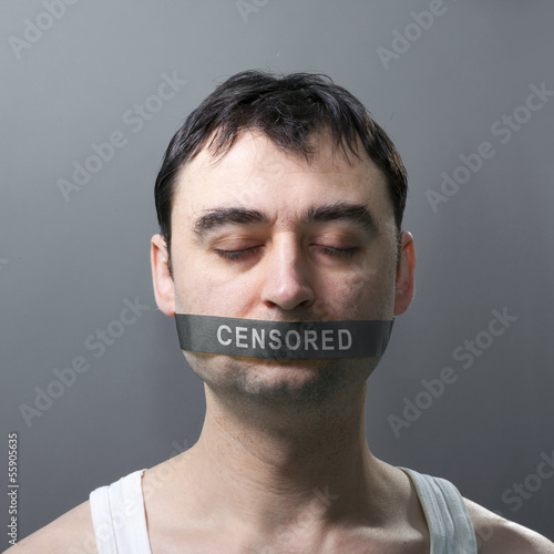 man with bandage on face