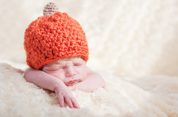 newborn in a cap