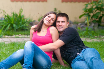 Young couple having fun in the garden