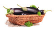 Fresh eggplants in wicker basket isolated on white