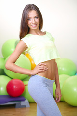 Pretty sporty girl in fitness room