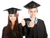 Two happy graduating students isolated on white