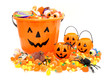Halloween Jack o Lantern pails with pile of candy