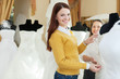 happy women chooses bridal outfit