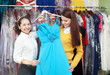 women chooses evening gown at  store