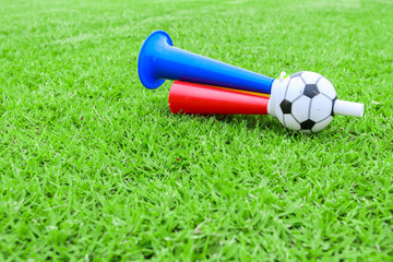 colorful football hooter on green grass