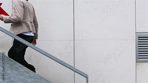 Business woman running up stairs