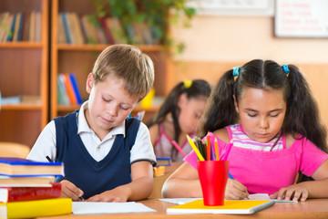 Schoolchildren during lesson in classroom at school