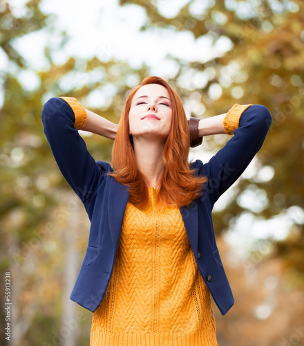 Redhead girl at autumn aoutdoor