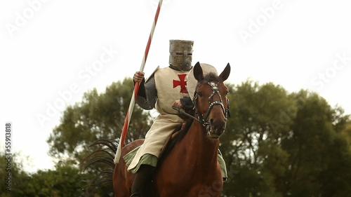 Medieval knight on horseback.