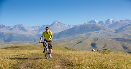 male riding a mountain bike