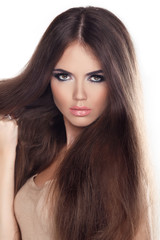 Beautiful woman with long brown hair. Closeup portrait of a fash