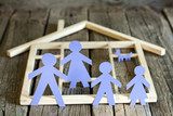 Family and home concept, paper silhouettes on wooden boards