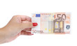 Woman hand holds fifty euro banknote