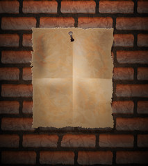 Brick background and old paper sheet nailed
