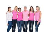 Smiling women wearing pink for breast cancer awareness