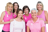 Smiling women posing and wearing pink for breast cancer