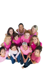 Cheerful pretty women looking up wearing pink for breast cancer