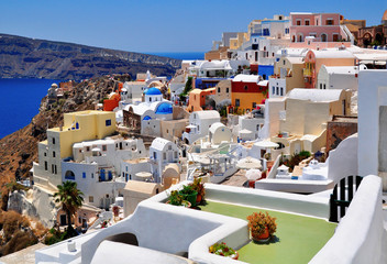 Typical and amazing colorful street in Santorini, Greece