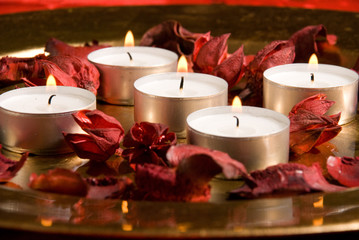 Candles on red and gold background