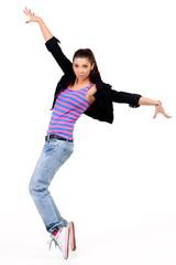 Attractive brunette performing dancing steps, hip hop